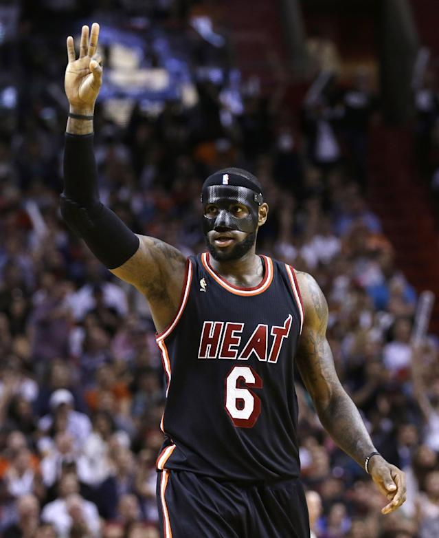 Miami Heat forward LeBron James celebrates after scoring a 3-pointer against the New York Knicks during the second half of an NBA basketball game in Miami, Thursday, Feb. 27, 2014. The Heat won 108-82. (AP Photo/Alan Diaz)