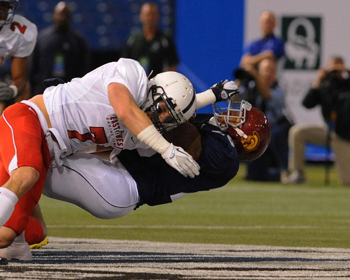 ST. PETERSBURG, FL - JANUARY 21: Defensive back Nick Sukay #7 of the Pennsylvania State University Nittany Lions tackles running back Marc Tyler #26 of the University of Southern California Trogans   during the 87th annual East-West Shrine game January 21, 2012 at Tropicana Field in St. Petersburg, Florida. (Photo by Al Messerschmidt/Getty Images)