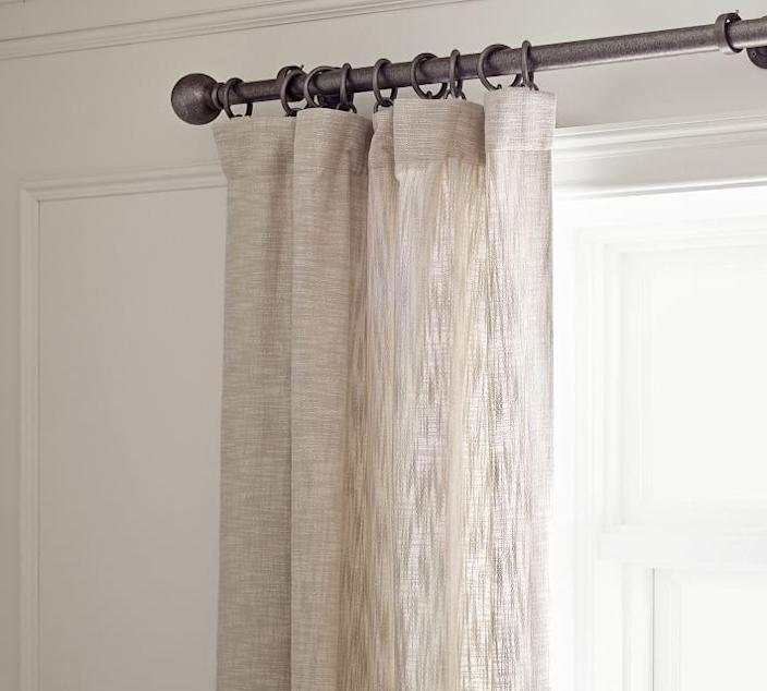 "Sometimes the simplest pieces are the most beautiful, and that is definitely the case with Pottery Barn's Seaton curtains. The machine washable textured cotton offers a casual and perfectly imperfect feel without compromising on style. You also have the option to add a blackout lining so that home movie nights in the living room feel like a trip to the theater. $89, Pottery Barn. <a href=""https://www.potterybarn.com/products/seaton-textured-drape-neutral/?"" rel=""nofollow noopener"" target=""_blank"" data-ylk=""slk:Get it now!"" class=""link rapid-noclick-resp"">Get it now!</a>"