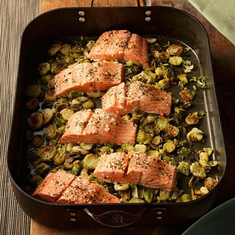 <p>Roasting salmon on top of Brussels sprouts and garlic, flavored with wine and fresh oregano, is simple enough for a weeknight meal yet sophisticated enough to serve to company. Serve with whole-wheat couscous.</p>
