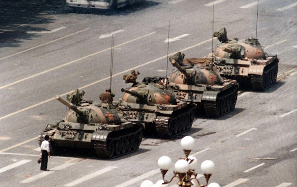 "<p>1989. AP Caption: A Chinese man stands alone to block a line of tanks heading east on Beijing's Cangan Blvd. in Tiananmen Square. The man, calling for an end to the recent violence and bloodshed against pro-democracy demonstrators, was pulled away by bystanders, and the tanks continued on their way. The Chinese government crushed a student-led demonstration for democratic reform and against government corruption, killing hundreds, or perhaps thousands of demonstrators in the strongest anti-government protest since the 1949 revolution. Ironically, the name Tiananmen means ""Gate of Heavenly Peace"".</p>"