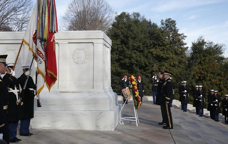 Spanish Prime Minister Mariano Rajoy, center, is accompanied by Army Maj. Gen. Jeffrey S. Buchanan, center right, as he lays a wreath at the Tomb of the Unknowns at Arlington National Cemetery, Monday, Jan. 13, 2014. Rajoy is in Washington to meet with President Barack Obama to discuss their support for the Transatlantic Trade and Investment Partnership, a proposed U.S.-European Union trade agreement currently in the midst of negotiations, and discuss promoting economic growth and jobs, cooperation within the North Atlantic Treaty Organization, their common interests in Latin America and challenges in North Africa and the Middle East. (AP Photo/Charles Dharapak)