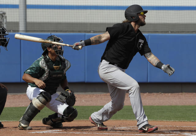 Major League Baseball free agent Jarrod Saltalamacchia bats in front of East Japan Railway Company catcher Watanabe during a scrimmage game Tuesday, Feb. 27, 2018, in Bradenton, Fla. (AP Photo/Chris O'Meara)