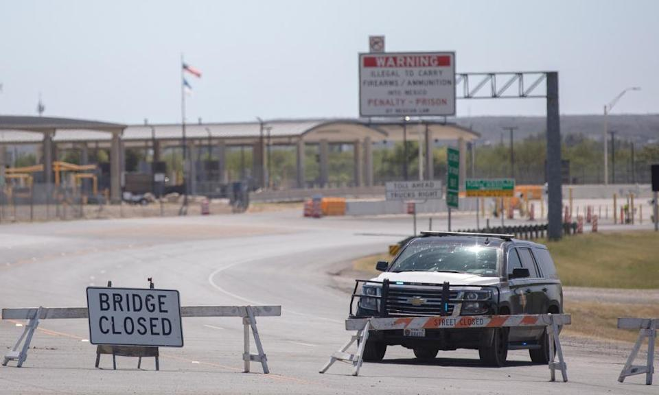 A Texas department of public safety highway patrol vehicle blocks the road leading to to the border crossing in Del Rio on 24 September.