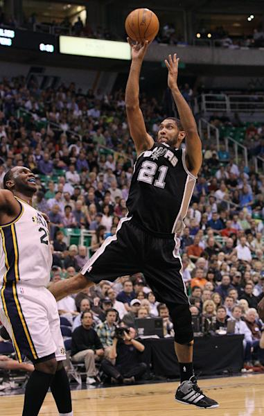 San Antonio Spurs center Tim Duncan (21) attempts a shot as Utah Jazz center Al Jefferson (25) defends during the first half of Game 4 in the first-round NBA basketball playoff series, Monday, May 7, 2012, in Salt Lake City. (AP Photo/Colin E Braley)