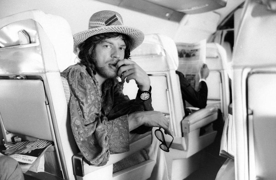 <p>Mick Jagger as he looks over his shoulder on an airplace, Brazil, early 1968.</p>