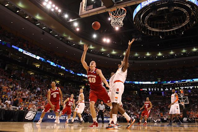 BOSTON, MA - MARCH 22: Jared Berggren #40 of the Wisconsin Badgers goes to the hoop against Rakeem Christmas #25 of the Syracuse Orange during their 2012 NCAA Men's Basketball East Regional Semifinal game at TD Garden on March 22, 2012 in Boston, Massachusetts. (Photo by Jim Rogash/Getty Images)