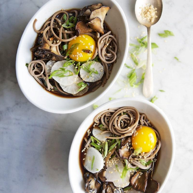 """The ginger-garlic broth for this savory soup couldn't be easier to make, and the maitake mushrooms called for in the recipe can be swapped out for whatever you have on hand. <a href=""""https://www.epicurious.com/recipes/food/views/soba-and-maitake-mushrooms-in-soy-broth-51205280?mbid=synd_yahoo_rss"""" rel=""""nofollow noopener"""" target=""""_blank"""" data-ylk=""""slk:See recipe."""" class=""""link rapid-noclick-resp"""">See recipe.</a>"""