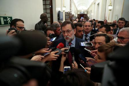 Spain's Prime Minister Mariano Rajoy talks to the media after attending the budget debate at parliament in Madrid, Spain April 26, 2018. REUTERS/Susana Vera