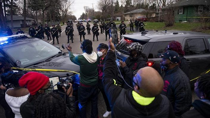 After Brooklyn Center police shot and killed Daunte White during a traffic stop, people gathered to confront the police. (Photo by Stephen Maturen/Getty Images)