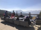 In this Oct. 3, 2020 photo, people gather in outdoor seats at the top of Aspen Mountain in Aspen, Colo. Aspen has not seen much of a drop-off in visitors during the coronavirus pandemic because of its numerous precautions in town and multitude of outdoor activities. (AP Photo/John Marshall)