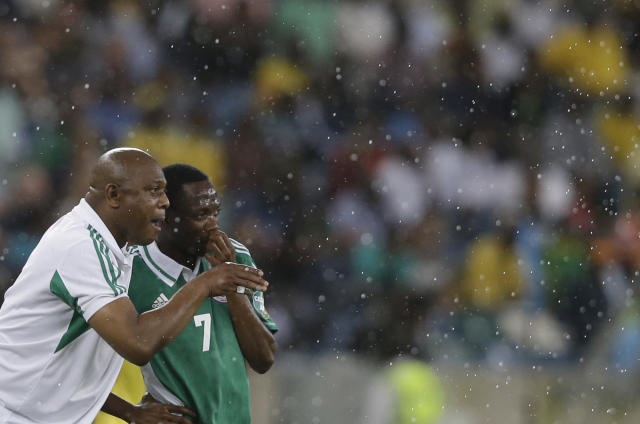 FILE - In this Feb. 6, 2013, file photo, Nigeria's head coach Stephen Keshi, left, talks to player Ahmed Musa, after Musa scored a goal during their African Cup of Nations semifinal soccer match against Mali, at Moses Mabhida Stadium in Durban, South Africa. After impressing on their way to the second round in each of their first two FIFA World Cup appearances, 1994 and 1998, Nigeria have struggled since: going out at the group stage three times while taking just two points from their last eight matches in the finals. (AP Photo/Rebecca Blackwell, File)