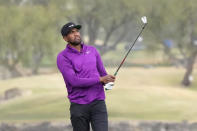 Tony Finau watches his approach shot from the 18th fairway during the third round of The American Express golf tournament on the Pete Dye Stadium Course at PGA West, Saturday, Jan. 23, 2021, in La Quinta, Calif. (AP Photo/Marcio Jose Sanchez)