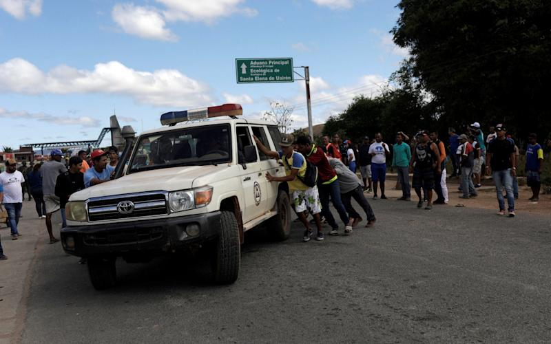 An ambulance carrying people injured during the border clashes - REUTERS
