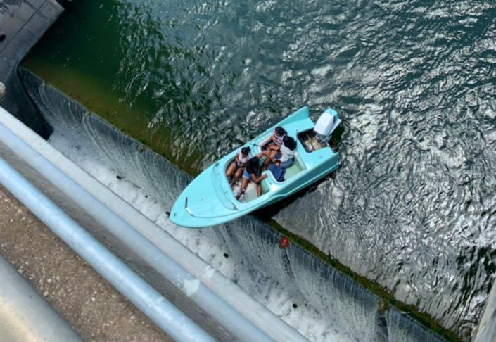 Four rescued after boat almost goes over edge of Texas dam
