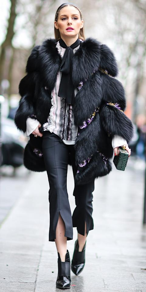 "<p>Palermo arrived at the Giambattista Valli show during Paris Fashion Week in a unique fur coat with floral embellishments, a lace-front blouse with a proper necktie, flared black capris, and a pair of black leather ankle boots (shop similar boots <a rel=""nofollow"" href=""http://www.anrdoezrs.net/links/7799179/type/dlg/sid/ISOliviaPalermoSSJimmyChooIJMarch/http://www.mytheresa.com/us_en/mazzy-65-leather-ankle-boots-661711.html?utm_source=affiliate&utm_medium=affiliate.cj.us"">here</a>).</p>"