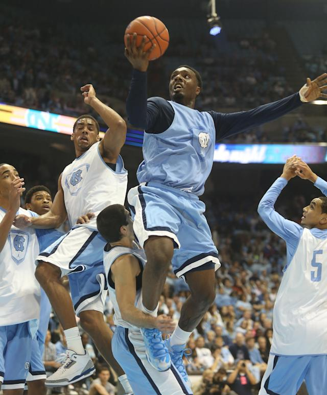 """North Carolina guard P.J. Hairston shoots during a scrimmage at """"Late Night With Roy,"""" a kickoff to the college basketball season in Chapel Hill, N.C. on Friday, Oct. 25, 2013. (AP Photo/Nell Redmond)"""