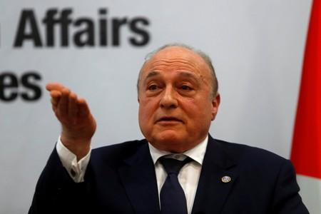 FILE PHOTO: Palestinian Finance Minister Shukri Bishara gestures during a news conference in Ramallah, in the Israeli-occupied West Bank