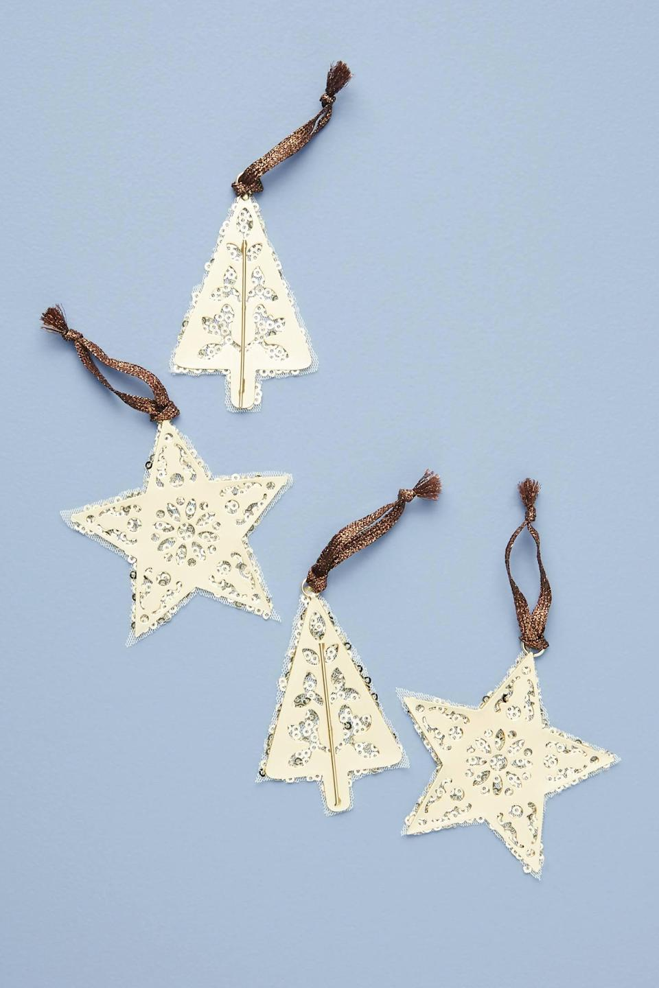 """<p>The metal detailing and sequins on the <a href=""""https://www.popsugar.com/buy/Holiday-Cheer-Ornaments-Set-Four-490592?p_name=Holiday%20Cheer%20Ornaments%2C%20Set%20of%20Four&retailer=anthropologie.com&pid=490592&price=24&evar1=casa%3Aus&evar9=46615300&evar98=https%3A%2F%2Fwww.popsugar.com%2Fhome%2Fphoto-gallery%2F46615300%2Fimage%2F46615463%2FHoliday-Cheer-Ornaments-Set-Four&list1=shopping%2Canthropologie%2Choliday%2Cchristmas%2Cchristmas%20decorations%2Choliday%20decor%2Chome%20shopping&prop13=mobile&pdata=1"""" rel=""""nofollow noopener"""" class=""""link rapid-noclick-resp"""" target=""""_blank"""" data-ylk=""""slk:Holiday Cheer Ornaments, Set of Four"""">Holiday Cheer Ornaments, Set of Four</a> ($24) are so pretty. </p>"""