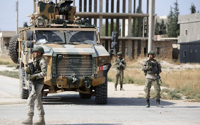 Turkish forces in the border town of Tal Abyad - AFP