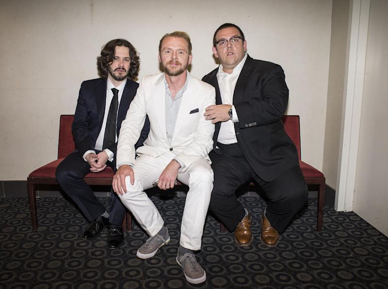 "In this Wed., Aug. 21, 2013 photo, from left, director Edgar Wright, actor Simon Pegg, and actor Nick Frost pose for a portrait in the green room at the premiere of the feature film ""The World's End"" at the Cinerama Dome, in Los Angeles. It's not the end of the world, but ""The World's End"" marks a creative conclusion for Pegg, Frost and Wright. For the British trio behind ""Shaun of the Dead"" and ""Hot Fuzz,"" the release on Friday, Aug. 23, 2013 of ""The World's End"" completes a trilogy. (Photo by Dan Steinberg/Invision/AP)"
