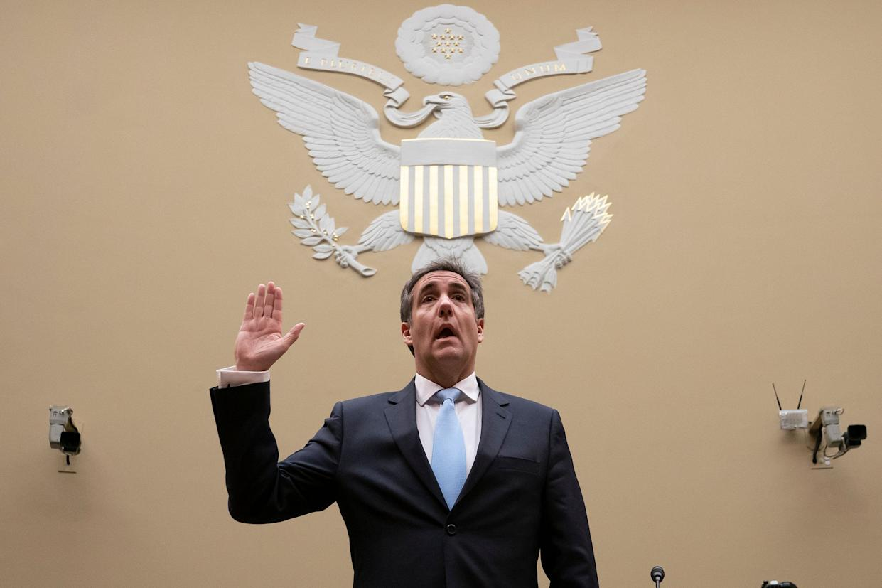 Michael Cohen is sworn in to testify before the House Oversight and Reform Committee on Wednesday. (Photo: J. Scott Applewhite/AP)
