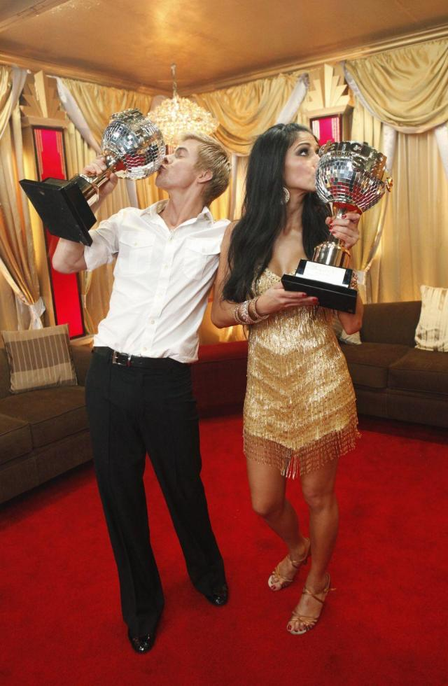 """<p>Nicole Scherzinger was paired with Derek, and that led them to the win for season 10. The former Pussycat Doll definitely has the moves, and <a href=""""https://youtu.be/gjyT6Rt985k"""" rel=""""nofollow noopener"""" target=""""_blank"""" data-ylk=""""slk:she showed that"""" class=""""link rapid-noclick-resp"""">she showed that</a>.</p>"""