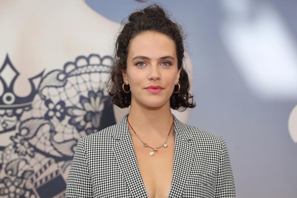 """Jessica Brown Findlay poses during a photocall for the TV show """"Harlots"""" as part of the 58th Monte-Carlo Television Festival on June 19, 2018 in Monaco. (Photo by VALERY HACHE / AFP via Getty Images)"""