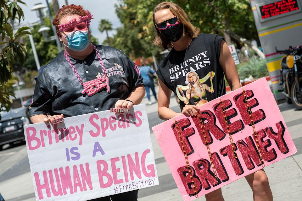 Supporters of the FreeBritney movement rally in support of musician Britney Spears following a conservatorship court hearing in Los Angeles, California on April 27, 2021. - Britney Spears has requested to speak in court in the legal battle over her father's control of her affairs, her attorney said April 27, 2021. The 39-year-old US pop singer is the subject of a