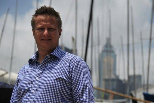 Author Cameron Dueck poses for a picture in Hong Kong. When Dueck set sail to the Canadian arctic to witness the front line of climate change, he did so knowing the icy seas he was to about navigate had claimed scores of sailors