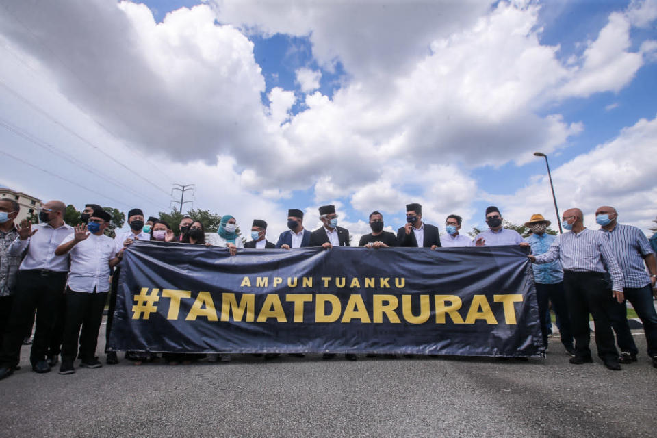Opposition leaders hold a banner in front of Istana Negara asking for an end to the Emergency, April 20, 2021. ― Picture by Hari Anggara