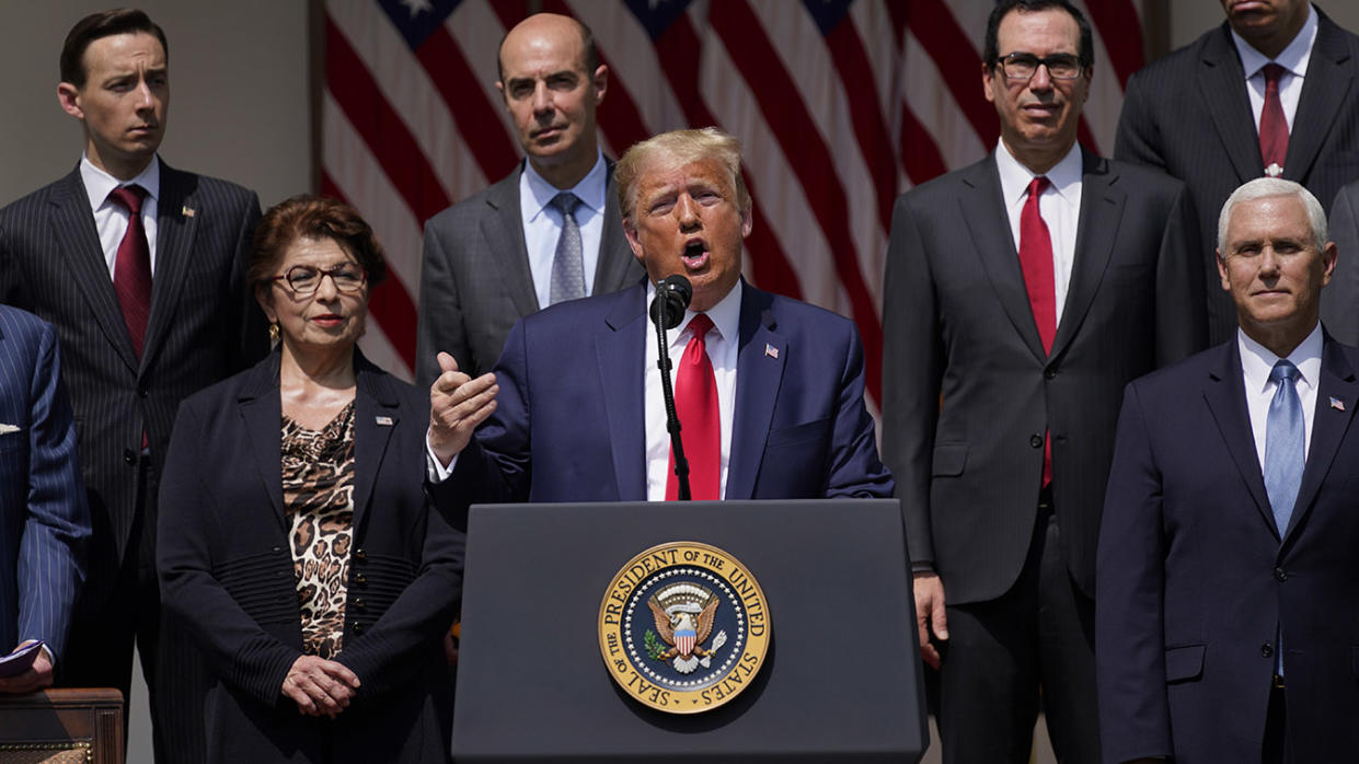 President Donald Trump speaks during a news conference in the Rose Garden of the White House, Friday, June 5, 2020, in Washington. Front row from left, Small Business Administration administrator Jovita Carranza, Trump, and Vice President Mike Pence. Back row from left, member of Council of Economic Advisers Tyler Goodspeed, Labor Secretary Eugene Scalia, Treasury Secretary Steven Mnuchin, and Chairman of the Council of Economic Advisers Tomas Philipson.(Evan Vucci/AP)
