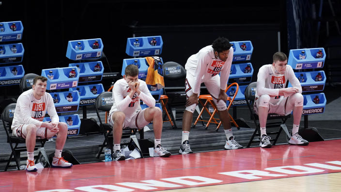 Illinois players watch from the bench in the final moments during the second half of a men's college basketball game against the Loyola Chicago in the second round of the NCAA tournament at Bankers Life Fieldhouse in Indianapolis, Sunday, March 21, 2021. Loyola Chicago won 71-58. (AP Photo/Paul Sancya)