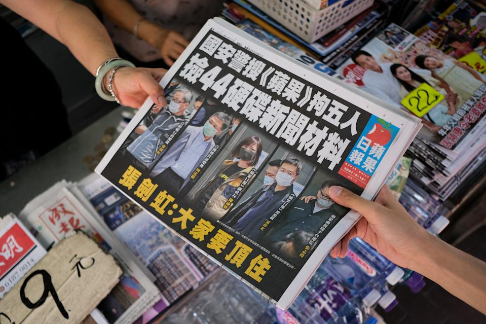 People bought an Apple Daily newspaper at the newsstand  in Hong Kong, China, on June 18, 2021. Apple Daily printed 500,000 copies of the pro-democracy paper. People in Hong Kong called for the purchase of Apple Daily as a sign of support. On Thursday, the Hong Kong police arrested five Apple Daily executives and top editors and blocked $18 million Hong Kong dollars in assets of media companies. (Photo by Leung Man Hei/NurPhoto via Getty Images)