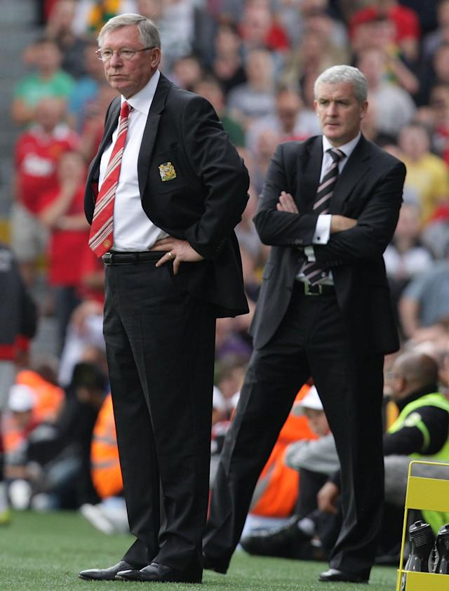 LONDON, ENGLAND - AUGUST 22: Sir Alex Ferguson of Manchester United and Mark Hughes of Fulham watch from the touchline during the Barclays Premier League match between Fulham and Manchester United at Craven Cottage on August 22, 2010 in London, England. (Photo by John Peters/Man Utd via Getty Images)