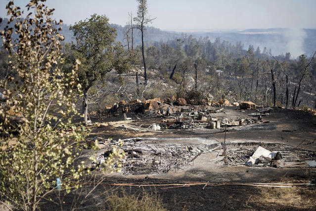 <p>The remains of a recreational vehicle rest in a clearing after a wildfire burned through the property on Saturday, July 8, 2017, near Oroville, Calif. The fire south of Oroville was one of more than a dozen burning in the state as firefighters worked in scorching temperatures to control unruly flames. (AP Photo/Noah Berger) </p>