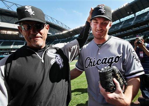 Chicago White Sox starting pitcher Phil Humber, right, is congratulated after pitching a perfect baseball game against the Seattle Mariners, Saturday, April 21, 2012, in Seattle. The White Sox won 4-0. (AP Photo/Elaine Thompson)