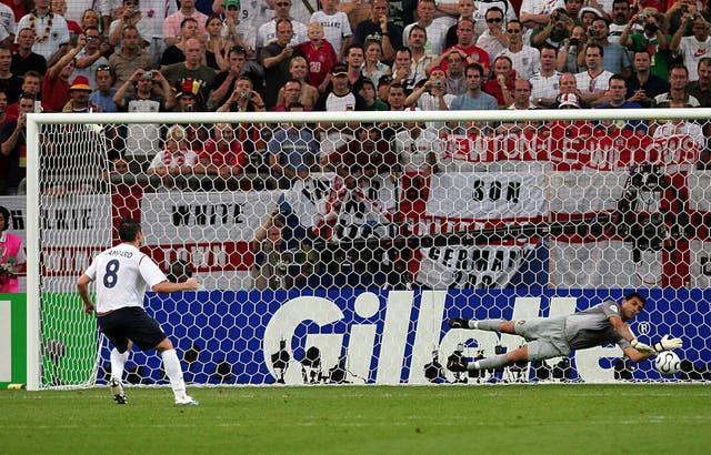 Portugal keeper Ricardo, right, saves from Frank Lampard in 2006