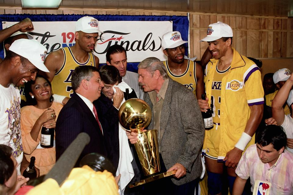 Los Angeles Lakers Owner Jerry Buss and the Los Angeles Lakers celebrate in the locker room after winning the 1987 NBA Finals against the Boston Celtics on June 14, 1987 in Los Angeles, California. Lakers 106 vs Celtics 93. (Photo by Andrew D. Bernstein/NBAE via Getty Images)