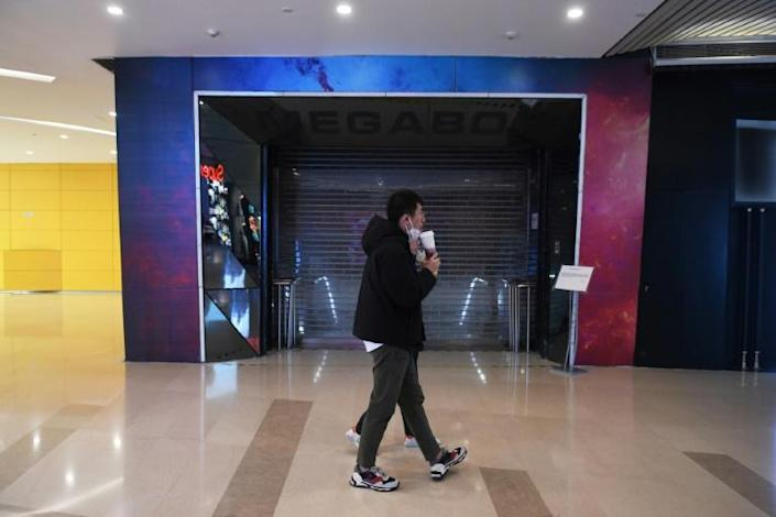 The Megabox cinema in Beijing has been closed for nearly a month in response to the coronavirus outbreak (AFP Photo/GREG BAKER)