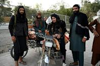 Taliban fighters are now in full control of Afghanistan -- here, fighters are seen in the capital Kabul