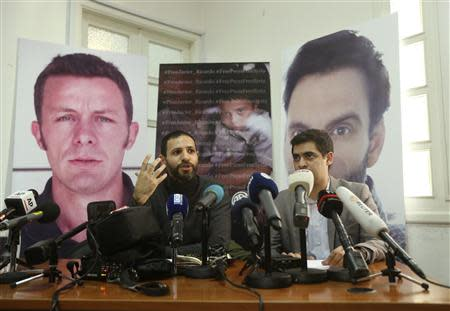 Correspondent Abdul-Ahad and Director of Samir Kassir Eyes Center for Media and Cultural Freedom Mhanna speak during a news conference in Beirut