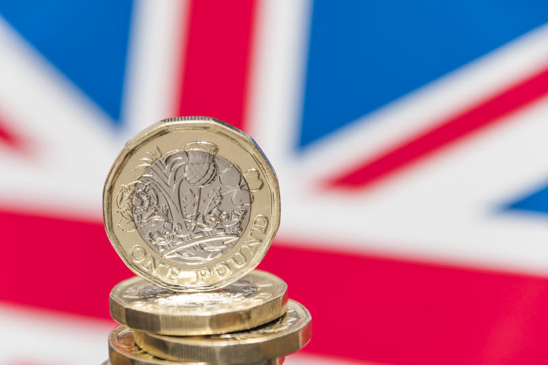 New UK £1 coin with British union jack flag. Photo: Getty