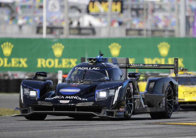 Ryan Briscoe drives the Konica Minolta Cadillac DPi-V.R during the Rolex 24 hour auto race at Daytona International Speedway, Saturday, Jan. 25, 2020, in Daytona Beach, Fla. (AP Photo/Terry Renna)