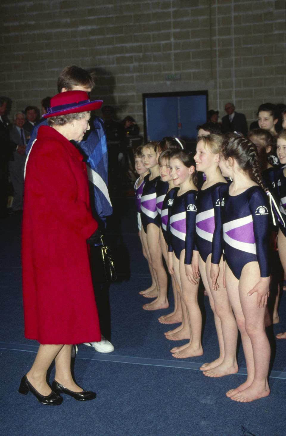 PORT REGIS, UNITED KINGDOM - FEBRUARY 23:  The Queen Visiting Port Regis School Where Their Grandchildren Zara And Peter Phillips Are Pupils. The Queen Is Talking To Zara Who Is Doing A Gymnastics Display.  (Photo by Tim Graham Photo Library via Getty Images)