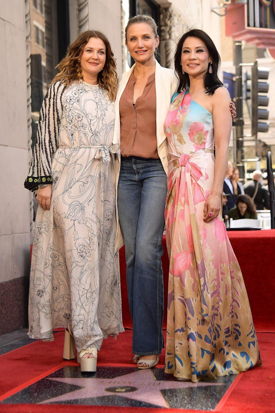 """<p>The girls reunited to celebrate Liu <a href=""""https://people.com/movies/charlies-angels-reunion-lucy-liu-drew-barrymore-cameron-diaz-at-walk-of-fame-ceremony/"""" rel=""""nofollow noopener"""" target=""""_blank"""" data-ylk=""""slk:receiving her star"""" class=""""link rapid-noclick-resp"""">receiving her star</a> on the Hollywood Walk of Fame in May 2019. </p> <p>""""My dear Angels, it's a 20-year reunion,"""" Liu said during the ceremony, as she looked over at her friends. """"20 years ago we were an elite crime-fighting team, and now look at us.""""</p>"""