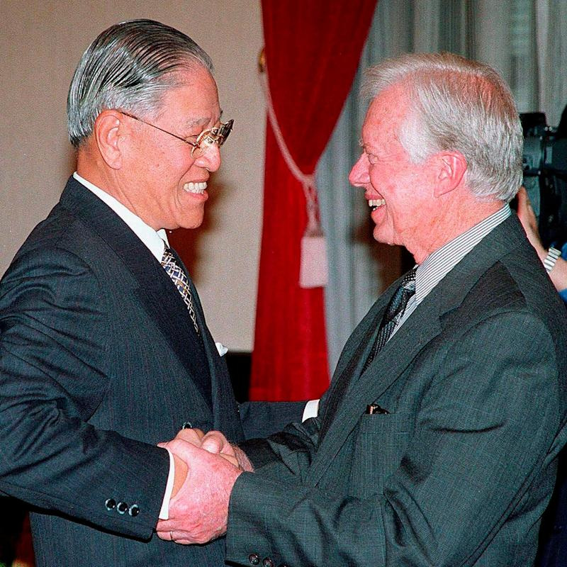 With the former US President Jimmy Carter in 1999 - AP