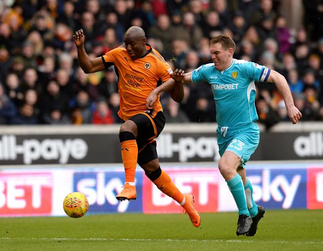 "Soccer Football - Championship - Wolverhampton Wanderers vs Burton Albion - Molineux Stadium, Wolverhampton, Britain - March 17, 2018 Wolves' Benik Afobe in action with Burton's Jake Buxton Action Images/Alan Walter EDITORIAL USE ONLY. No use with unauthorized audio, video, data, fixture lists, club/league logos or ""live"" services. Online in-match use limited to 75 images, no video emulation. No use in betting, games or single club/league/player publications. Please contact your account representative for further details."