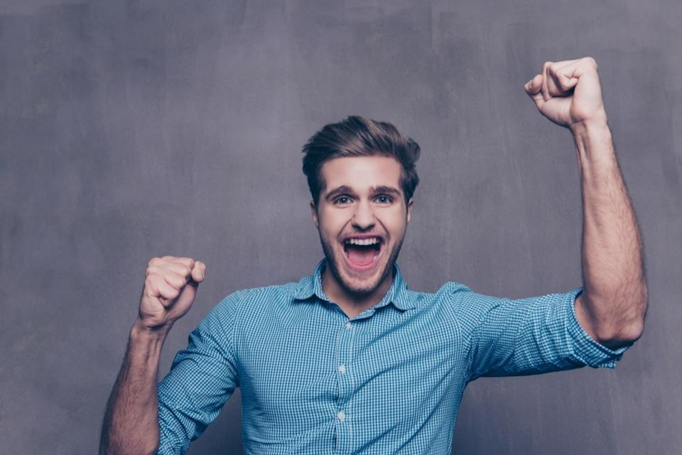 excited guy in a blue shirt
