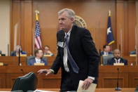 Thad Hill, Calpine President and CEO, departs after he appeared to answer questions a the Committees on State Affairs and Energy Resources holding a joint public hearing to consider the factors that led to statewide electrical blackouts, Thursday, Feb. 25, 2021, in Austin, Texas. The hearings were the first in Texas since a blackout that was one of the worst in U.S. history, leaving more than 4 million customers without power and heat in subfreezing temperatures. (AP Photo/Eric Gay)